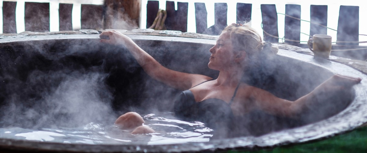 Women in warm hot tub during the winter